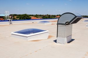 Flat roof with ventilation & skylight on industrial building